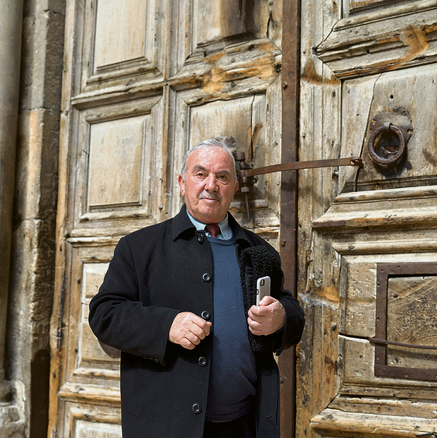 Wajeeh Nusseibeh stands by the church's locked door. 'A great honor has been bestowed upon us'  (Photo: Amit Shabi)