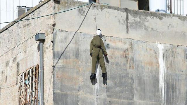 Soldier effigy hanging in Meah Shearim (Photo: Chaim Goldberg)