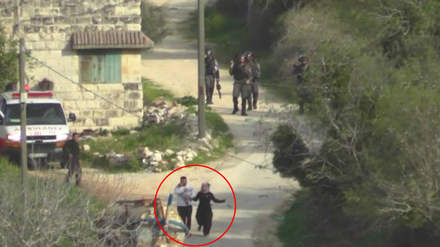 The Yesh Din footage showed a Border Policeman throw a stun grenade at Palestinian parents carrying an infant (circled) (Photo: Yesh Din)
