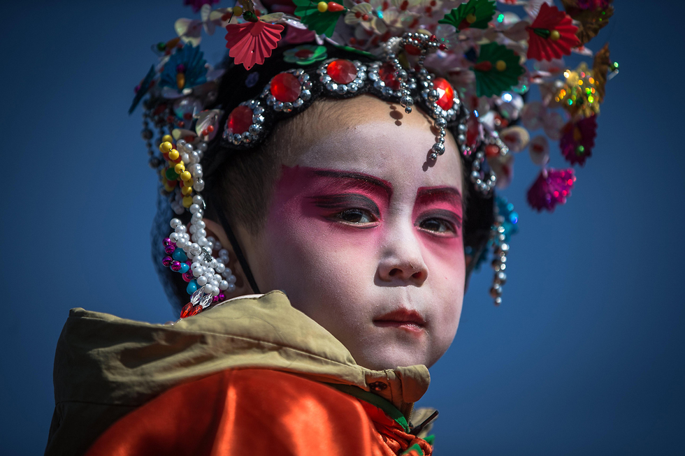 בעיר ז'אנגג'יאקו שבסין חגגו את פסטיבל הפנסים המסורתי (צילום: EPA) (צילום: EPA)