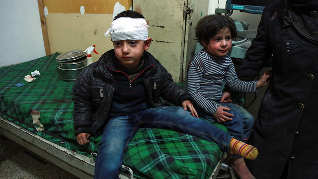 Syrian children wounded in Ghouta bombings (Photo: AFP)