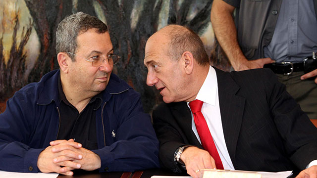 Then-Prime Minister Olmert, right, with his Defense Minister Barak