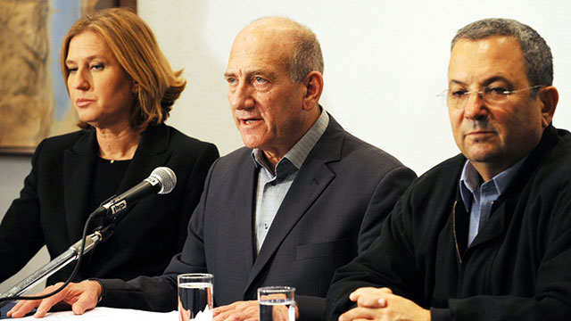 Then-Prime Minister Olmert, center, with his Foreign Minister Livni, left, and Defense Minister Barak, right