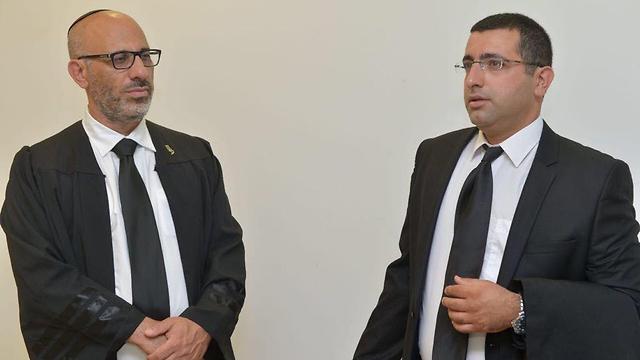 עורכי הדין יהודה פריד וטל גבאי ()
