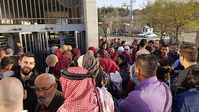 East Jerusalem residents at the Population Authority's offices in Wadi al-Joz