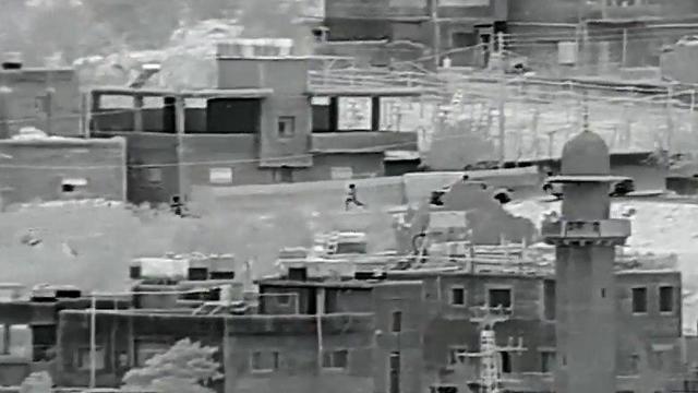 The terrorists fleeing (Photo: IDF Spokesman's Office)