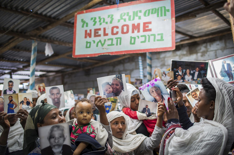 Members of Ethiopia's Jewish community hold pictures of their relatives in Israel, during a solidarity event at the synagogue in Addis Ababa (Photo: AP)