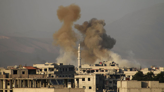 Eastern Ghouta under fire (Photo: AFP)