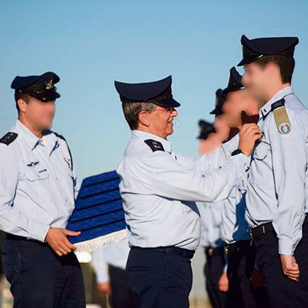 In this June 2017 photo, Eshel is seen presenting graduates of the IAF Flight Academy's174th class with their flight wings  (Photo: IDF Spokesperson's Unit)