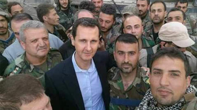 Syrian President Assad (center). The Iranian drone was not meant to protect his regime, Halevi said