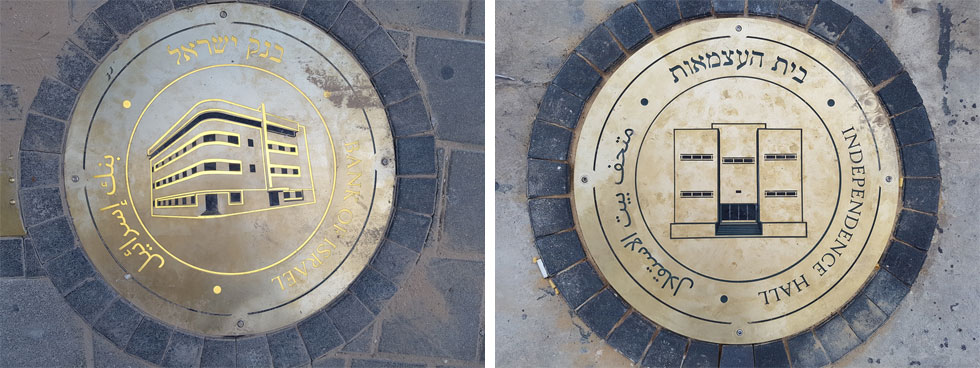 אבני הדרך, שמציגות את האתרים ההיסטוריים כאשר עוברים לצדם, מורכבות מלוחות פליז מעוגלים עם לוגואים מאוירים של המבנים והפסלים (צילום: אורן אלדר)