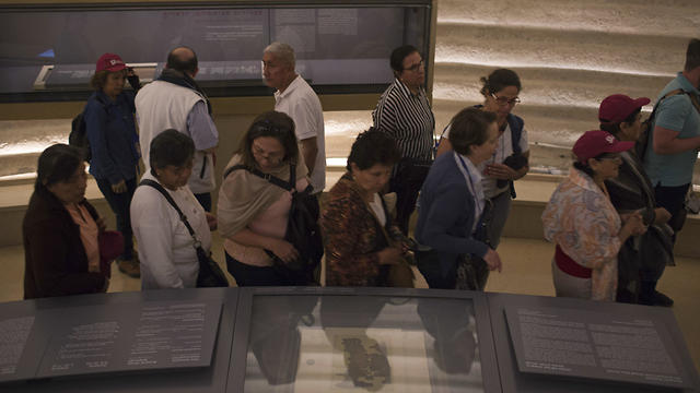 Visitors admiring the ancient scroll (Photo: AP)