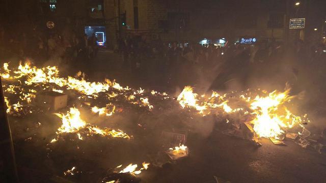 Yated Ne'eman copies burned (Photo: Chaim Goldberg)