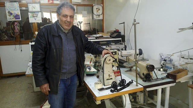 Slama at his sewing machine repair shop (Photo: AP)