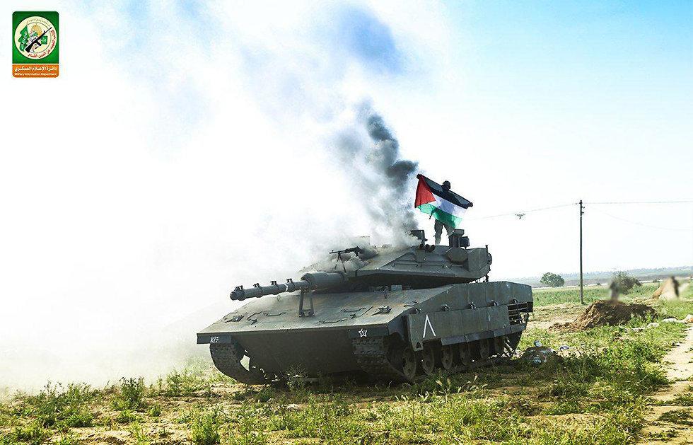Palestinian flag atop a replica of an Israeli Merkava tank