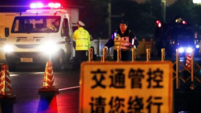 חסימות בלב בייג'ינג סין דיווח על ביקור פתע של קים ג'ונג און (צילום: רויטרס)