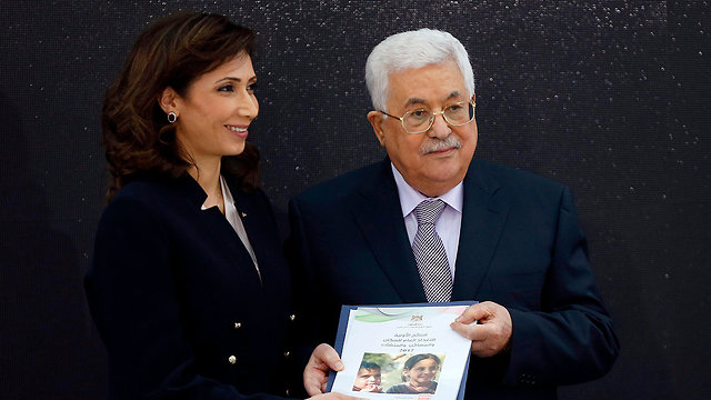 Ala Awed and President Mahmoud Abbas (Photo: AFP)