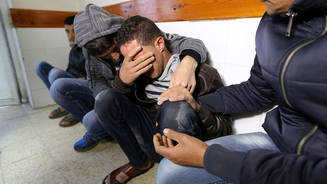 Relatives, friends of Samour mourn him at the hospital (Photo: Reuters)