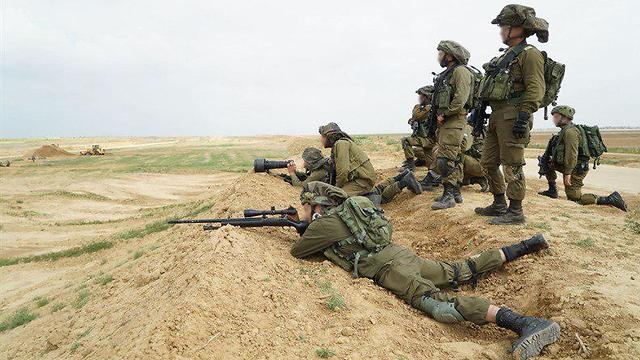 IDF snipers taking aim at main instigators (Photo: IDF Spokesperson's Office)