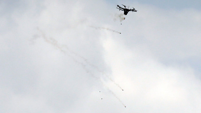 Drone drops tear gas onto Palestinian rioters in Gaza (Photo: AFP)