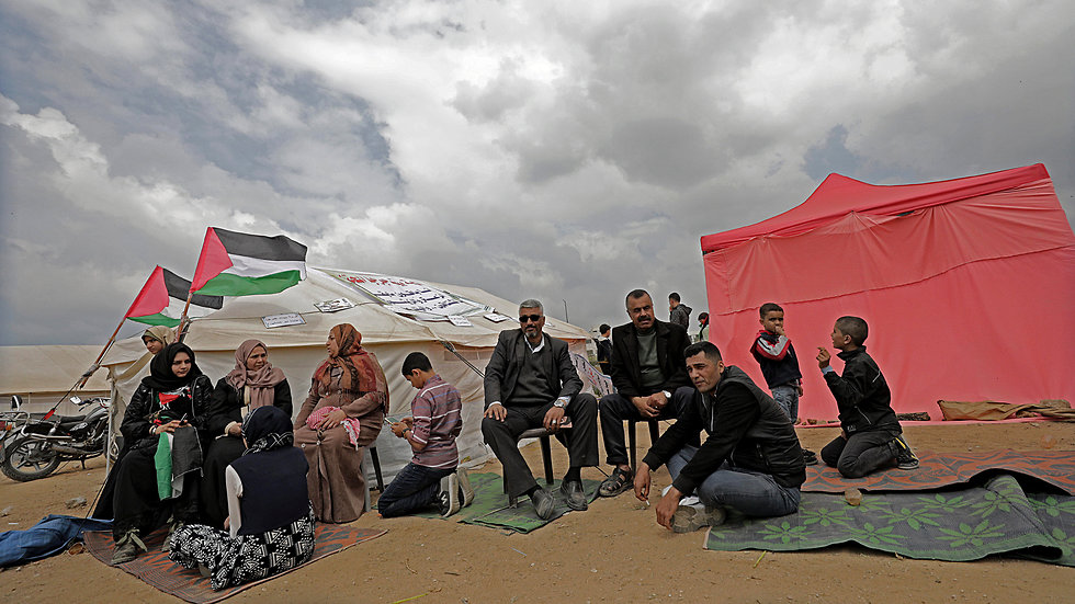 A Palestinian family at one of the tent encampments by the Gaza border on Friday (Photo: EPA)