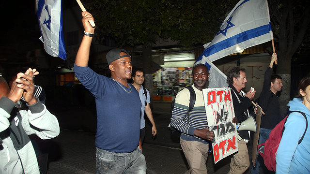 Asylum seekers celebrating the agreement in south Tel Aviv, minutes before it was suspended (Photo: Yariv Katz)