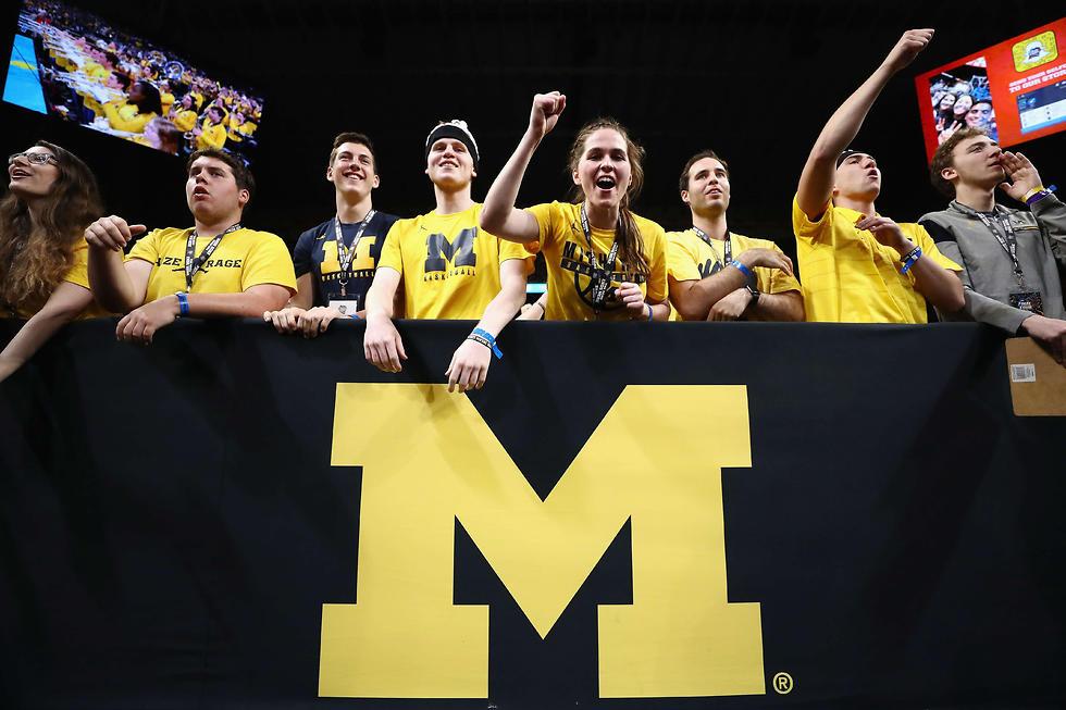 אוהדי מישיגן גמר מכללות (צילום: AFP)