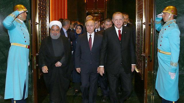 נשיא איראן חסן רוחאני נשיא רוסיה ולדימיר פוטין נשיא טורקיה רג'פ טאיפ ארדואן ב אנקרה (צילום: רויטרס)