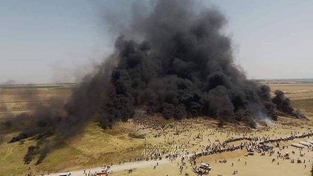 Tires burning near the Gaza border during Friday's protest