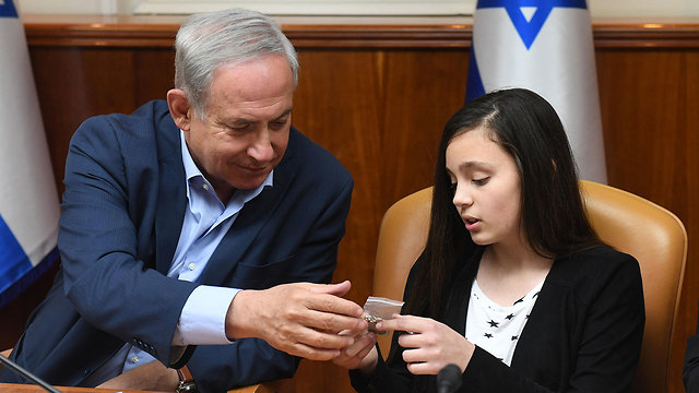Netanyahu and a young IDF orphan (Photo: Gov. Press Office)