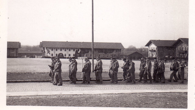 Captured SS soldiers marched through the Dachau concentration camp (Photo: Massuah Institute for Holocaust Studies)