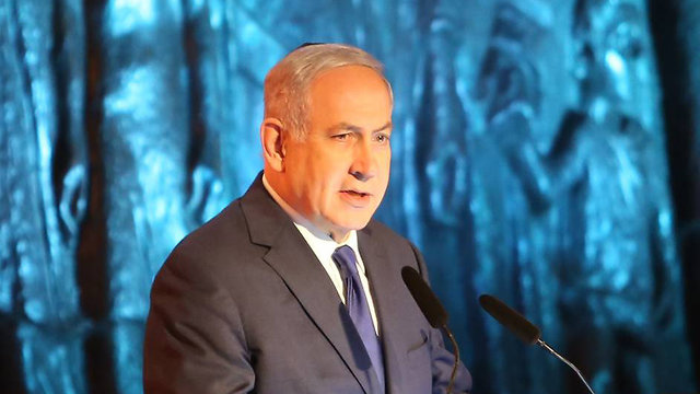 Speaking at the Yad Vashem ceremony, PM Netanyahu said Iran should not 'test Israel's resolve' (Photo: Gil Yohanan)