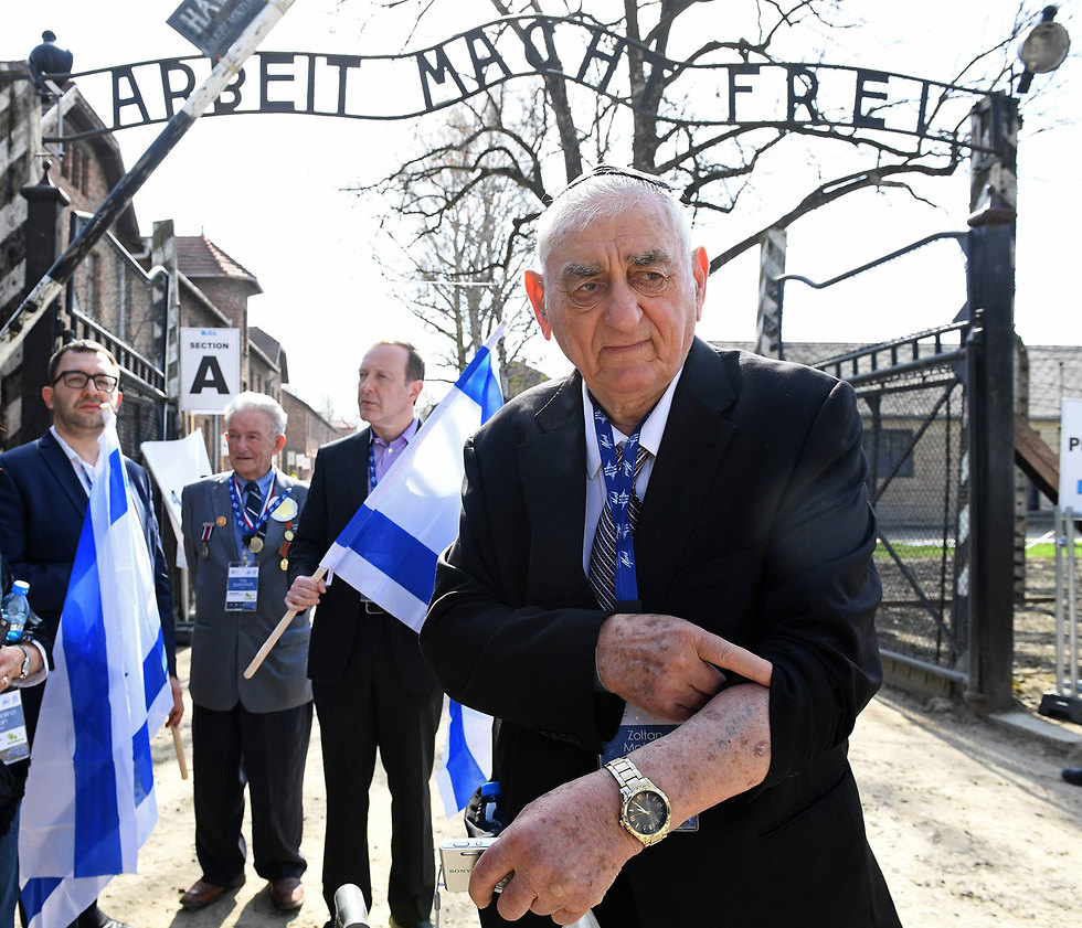 A Holocaust survivor shows the number on his arm as he visits the Auschwitz death camp as part of the 2018 March of the Living  (Photo: AFP)