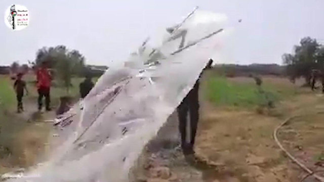 A Palestinian carrying an incendiary kite