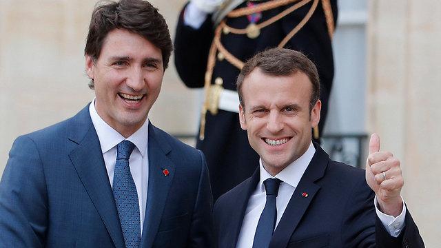 נשיא צרפת עמנואל מקרון ו ג'סטין טרודו ראש ממשלת קנדה ב פריז (צילום: EPA)