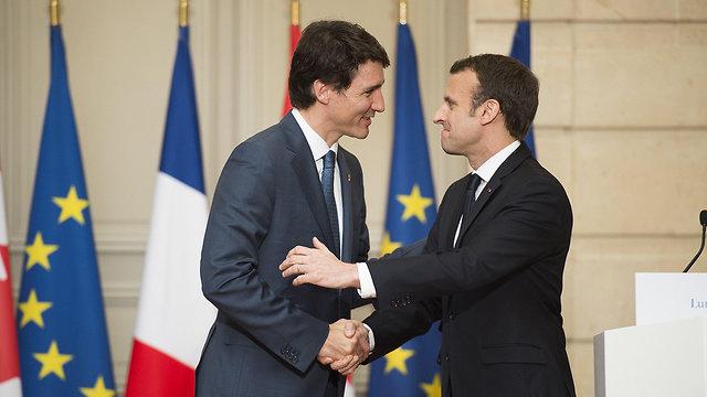 נשיא צרפת עמנואל מקרון ו ג'סטין טרודו ראש ממשלת קנדה ב פריז (צילום: MCT)