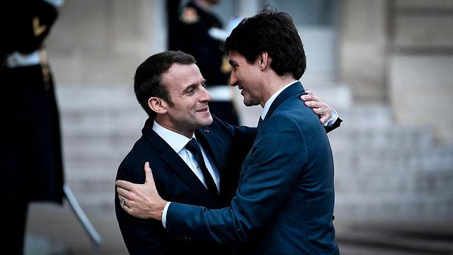 נשיא צרפת עמנואל מקרון ו ג'סטין טרודו ראש ממשלת קנדה ב פריז (צילום: AFP)