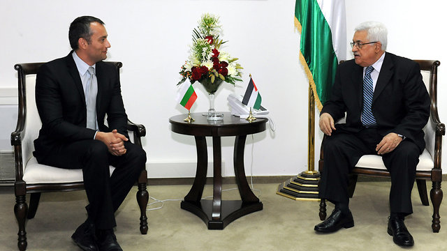 With Mahmoud Abbas (Photo: Getty Images)