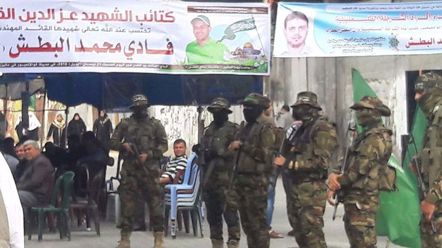 Members of Hamas's military wing at the entrance to Albatsh's mourners' tent