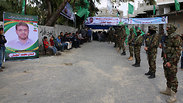 Members of Hamas's military wing at the entrance to Albatsh's mourners' tent in Gaza (Photo: AP)