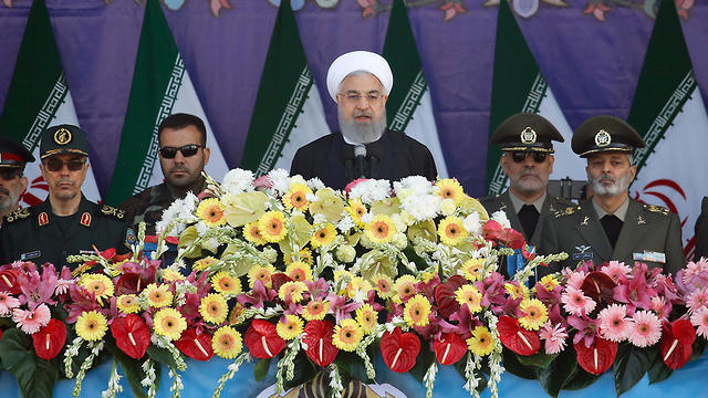 Hassan Rouhani says consequences to be severe if deal is betrayed (Photo: EPA)