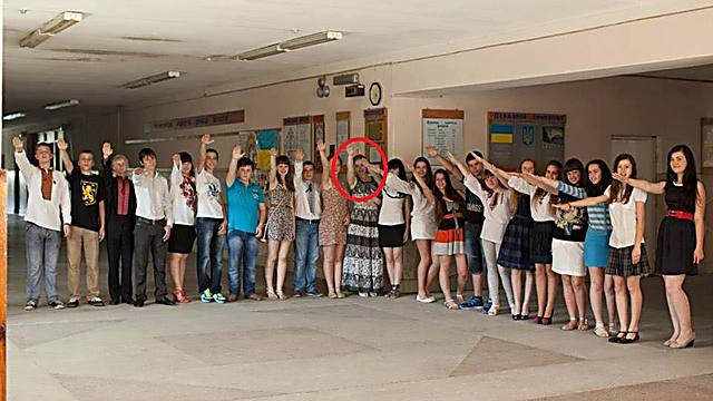 Teacher Marina Batyuk (circled) and her students giving the Nazi salute