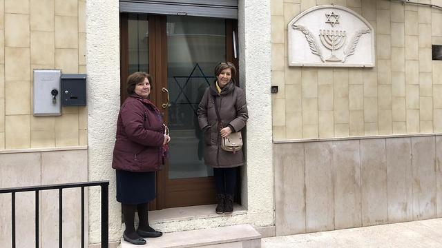 Lucia Zorro and her sister Josephina outside the village synagogue