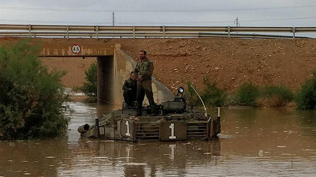 Shizafon Armor Corps Training Base flooded, soldiers forced to take refuge on top of tank