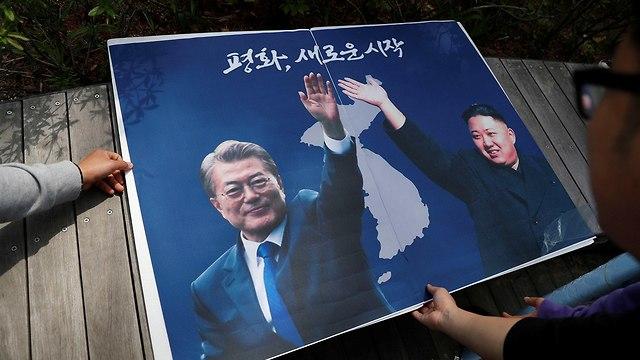 עצרת ב סיאול למען איחוד הקוריאות נשיא דרום קוריאה מון ג'אה אין שליט צפון קוריאה קים ג'ונג און (צילום: רויטרס)