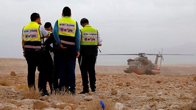 כוחות חילוץ בנחל צופית (צילום: AFP)