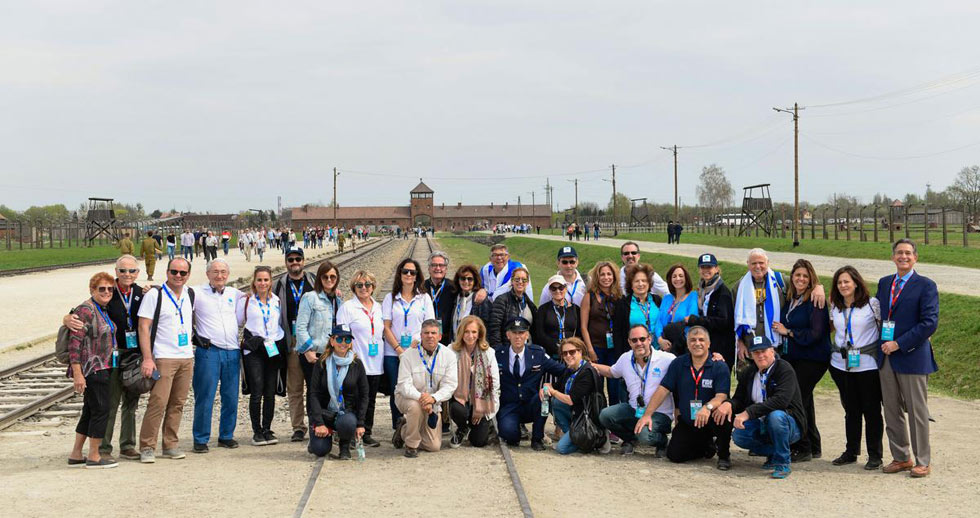 FIDF supporters from Miami on the tracks leading to Auschwitz-Birkenau on April 15  (Photo: Shahar Azran)