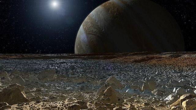 מבט לכוכב הלכת צדק מהירח אירופה (צילום: נאס