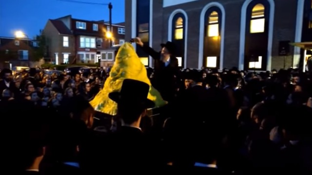Fuel being poured on the bonfire (Photo: Yeshiva World News)