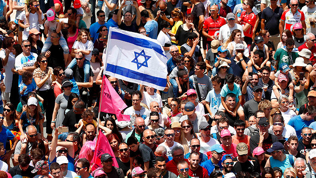 Spectators in Haifa (Photo: AFP)